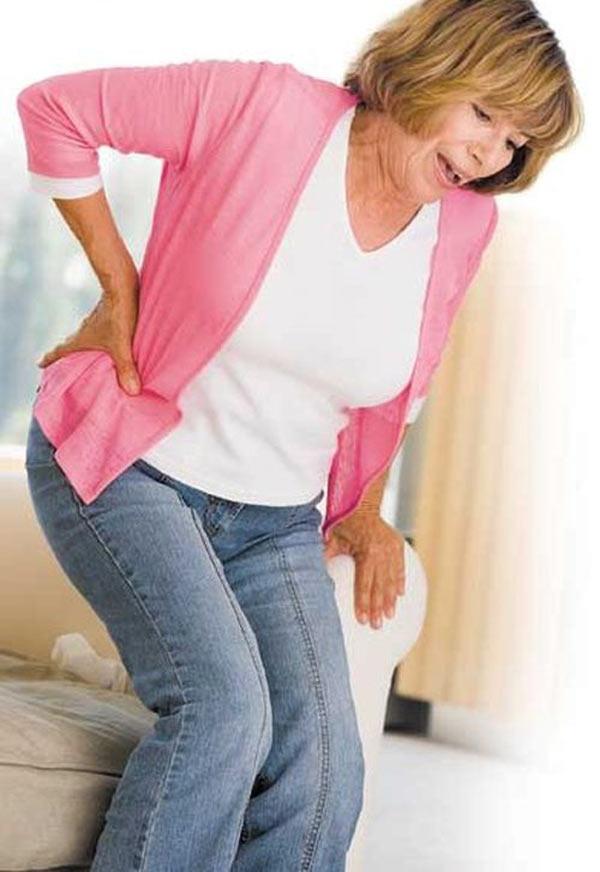 Почему болит в спине ниже поясницы у женщин